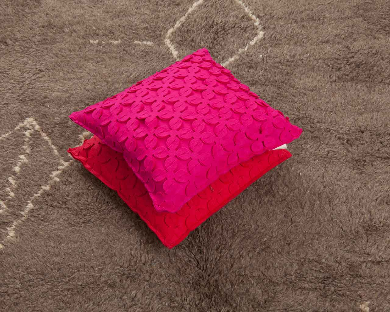 bynasia pink pillows grey carpet white pattern 1