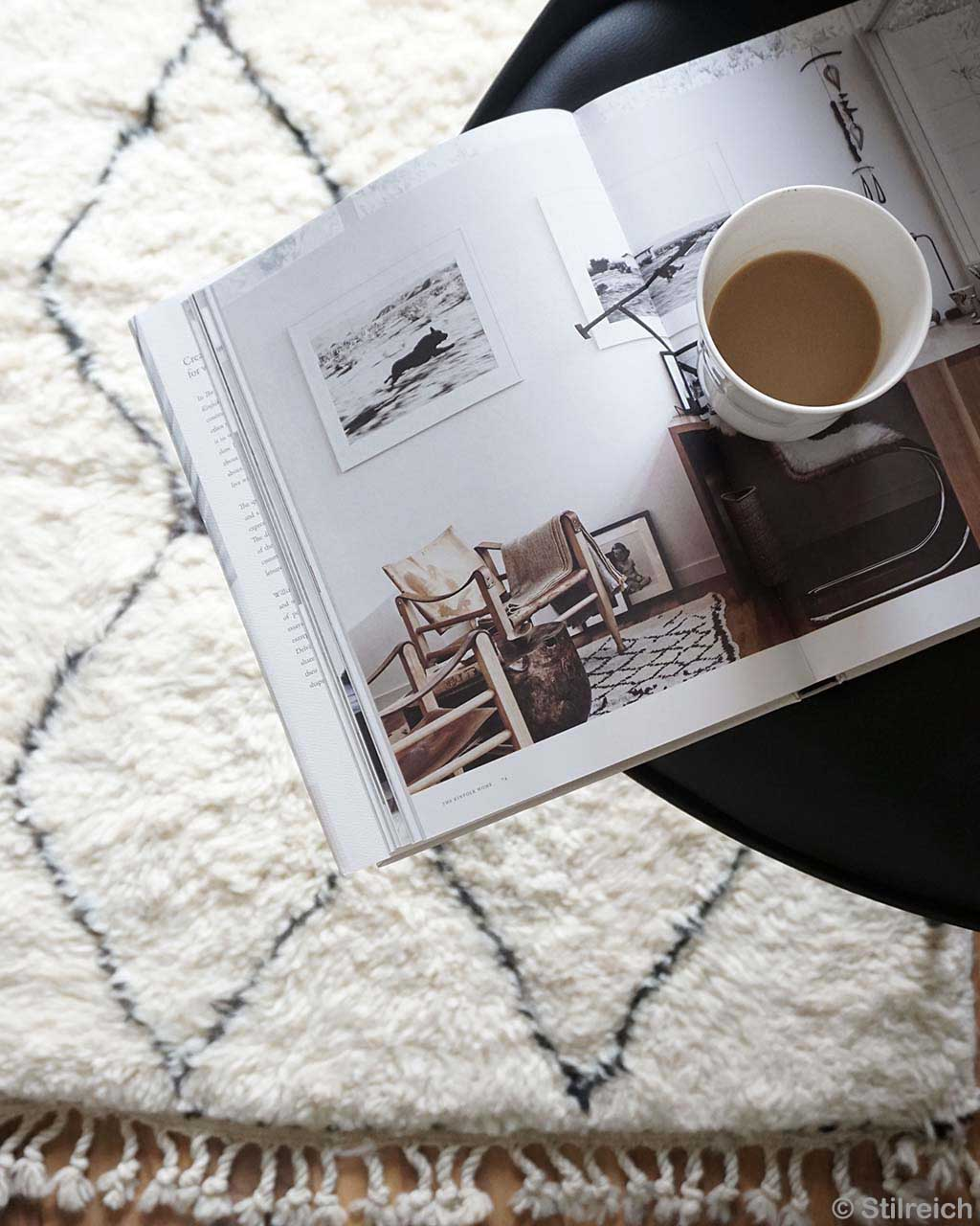cup of tea on magazine from morocco modern rugs