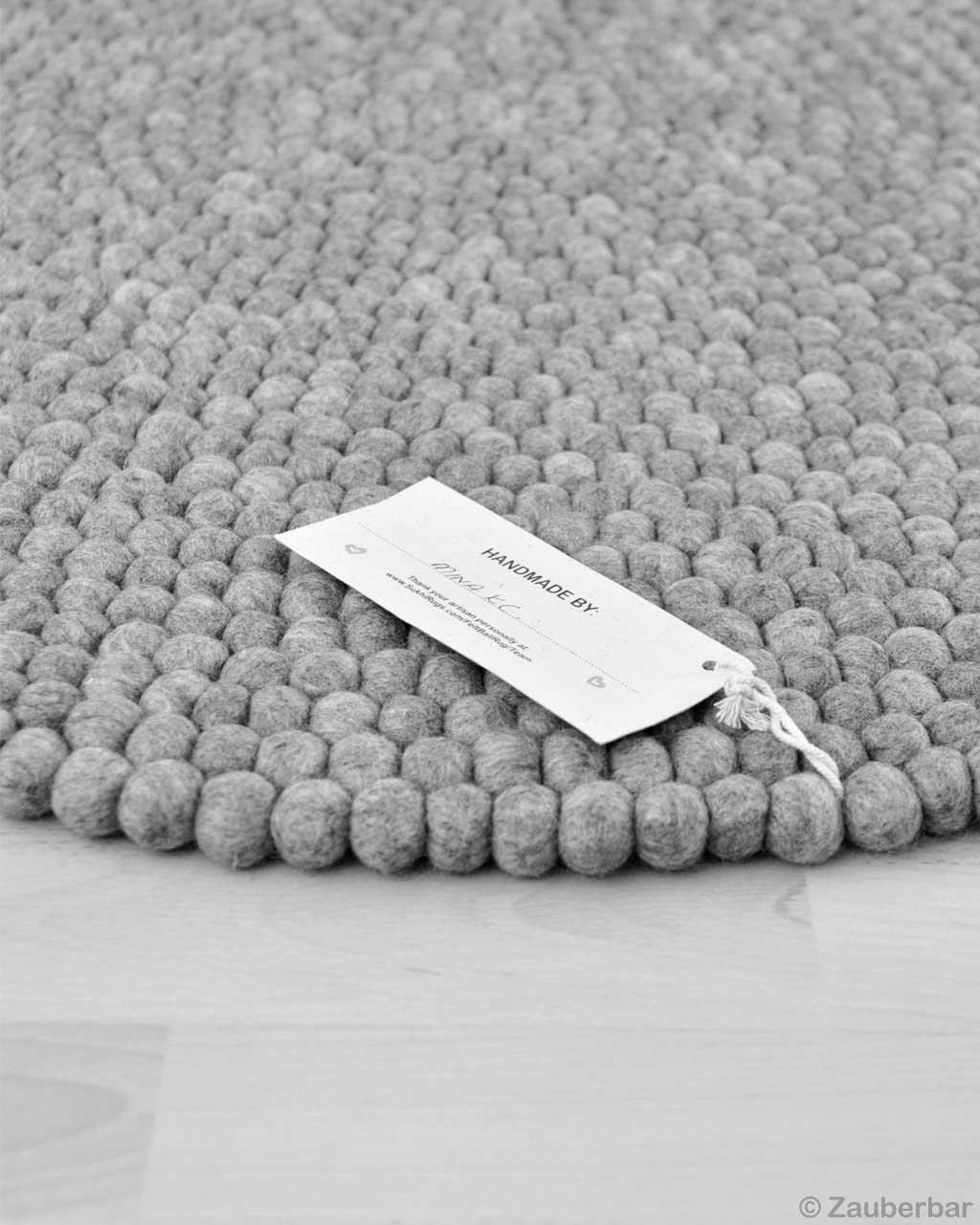 hand knotted nepalian made round light gray felt ball kitchen rugs