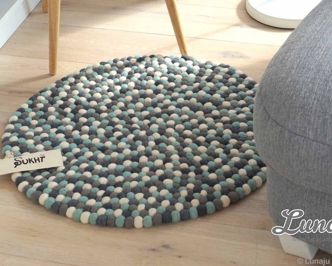 made by nepalian gray white and cyan felt ball small rug