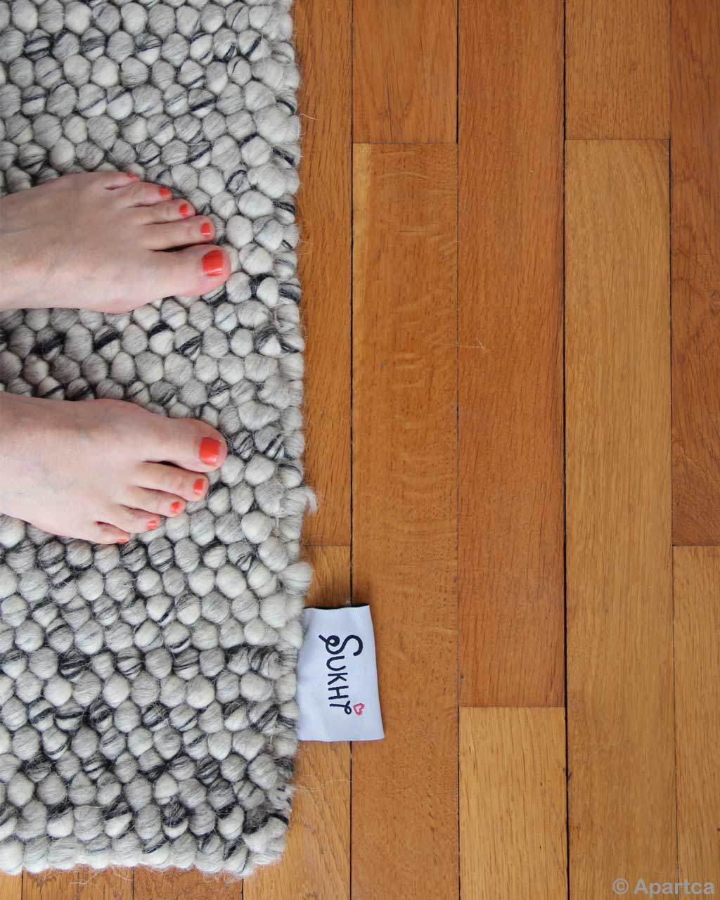 red nail polished feet contemporary geometric rug