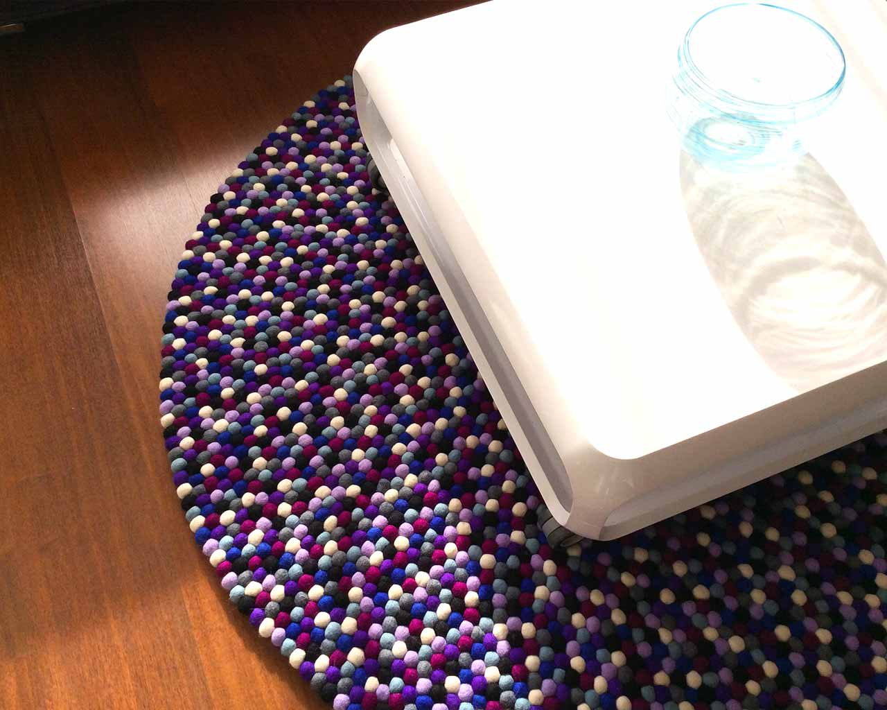 white table round purple felt ball carpet