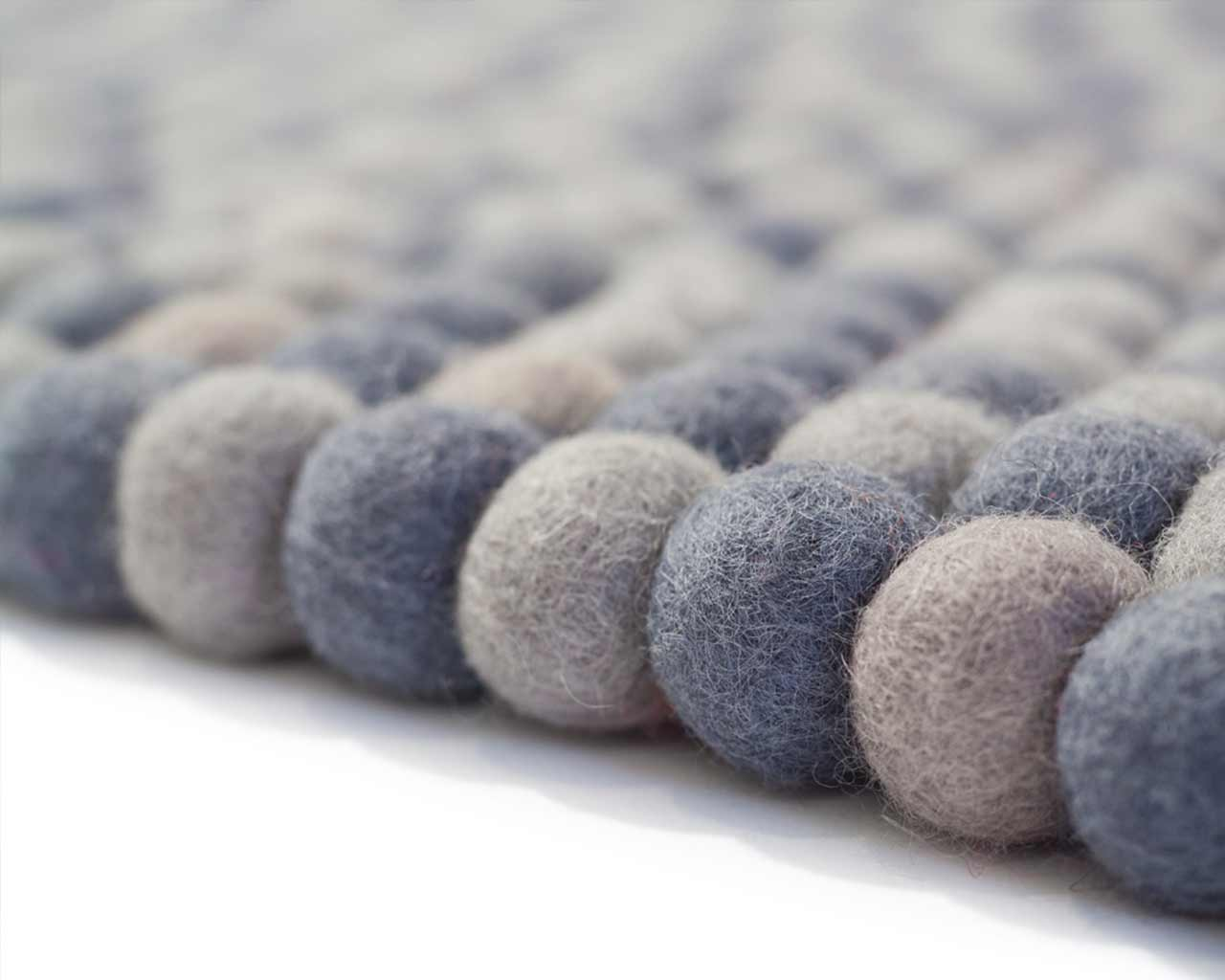 close up felt ball rug