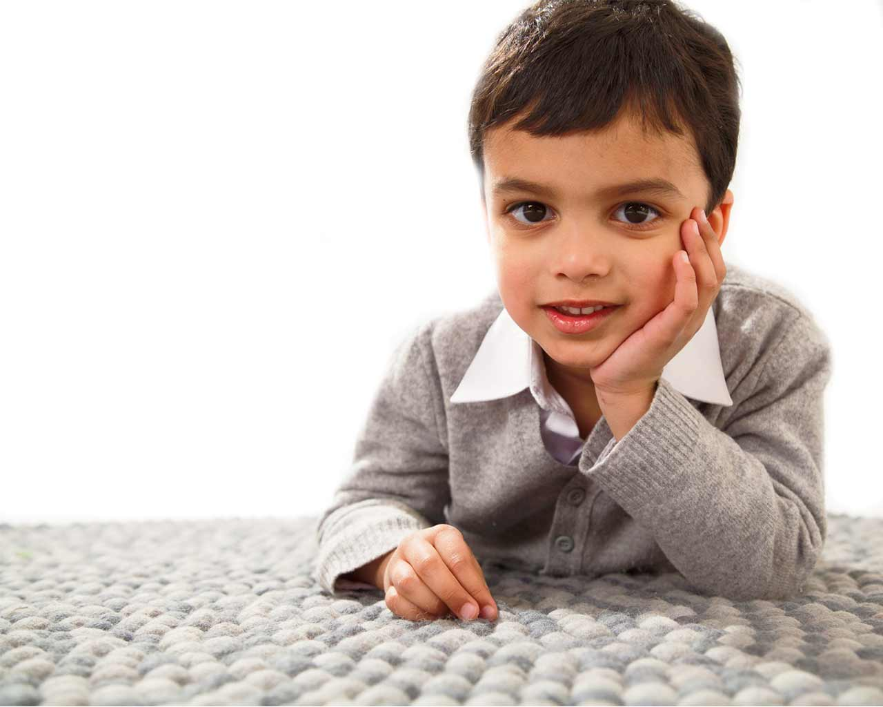 model kid carpet sit on rug