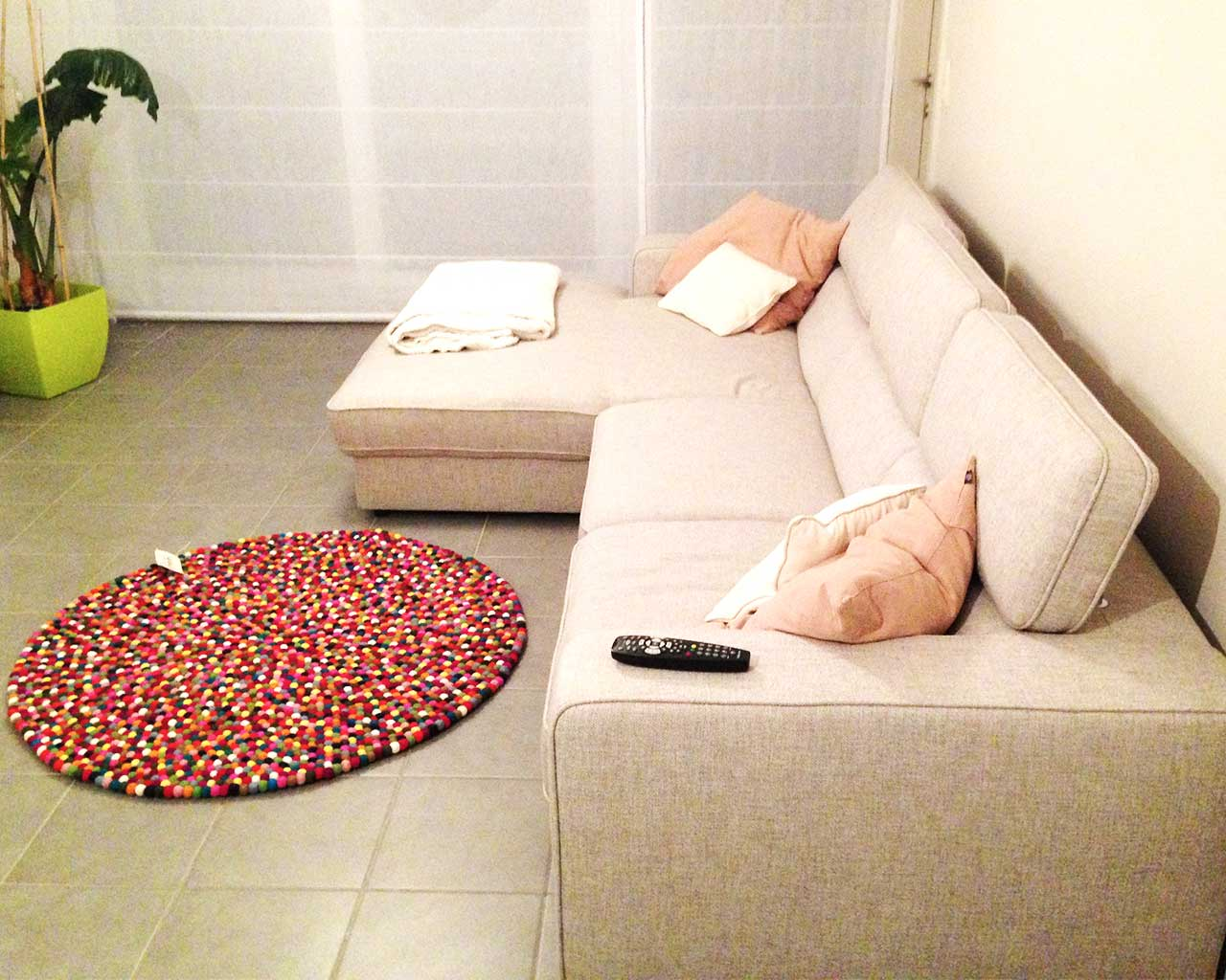 white couch salon colorful rug
