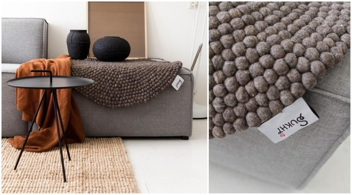 brown-felt-ball-rug-on-couch-in-living-room